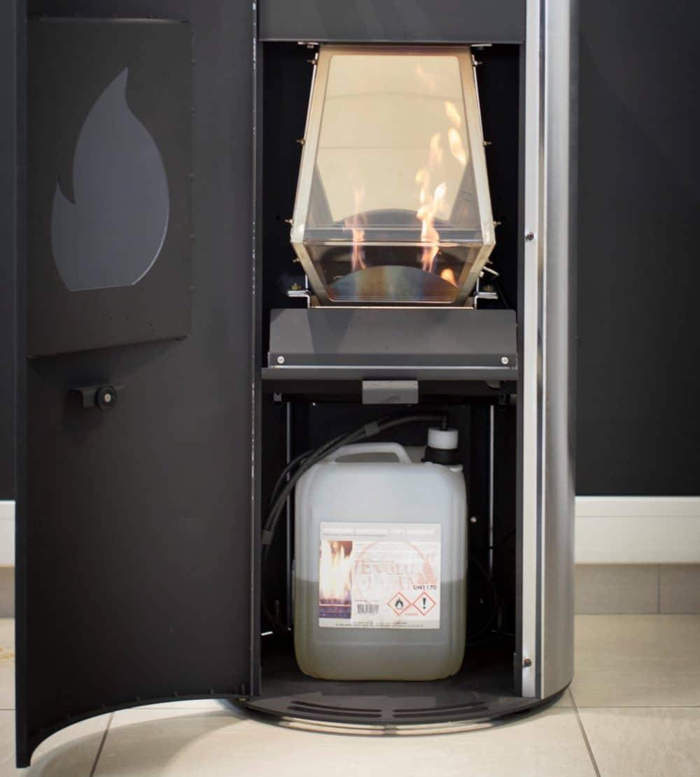 Intérieur poêle Flam'In compartiment bidon bioéthanol et cage de chauffe